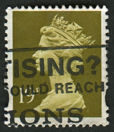 definitive: UK-CIRCA 1993:A stamp printed in UK shows image of Elizabeth II is the constitutional monarch of 16 sovereign states known as the Commonwealth realms, in Bistre, circa 1993.