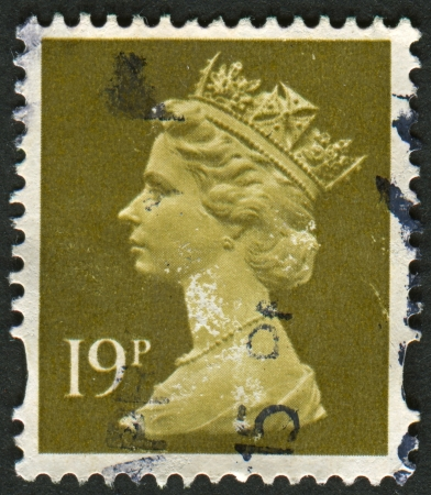 realms: UK-CIRCA 1993:A stamp printed in UK shows image of Elizabeth II is the constitutional monarch of 16 sovereign states known as the Commonwealth realms, in Bistre, circa 1993.