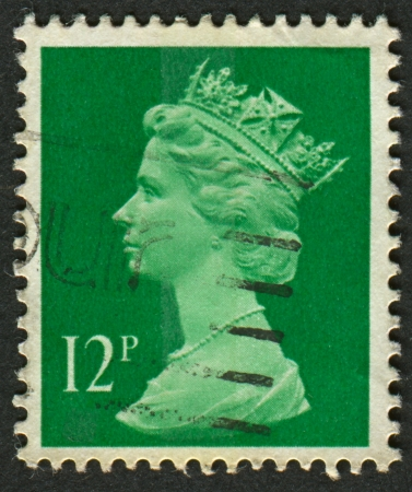 constitutional: UK-CIRCA 1985: A stamp printed in UK shows image of Elizabeth II is the constitutional monarch of 16 sovereign states known as the Commonwealth realms, in Bright Emerald, circa 1985.