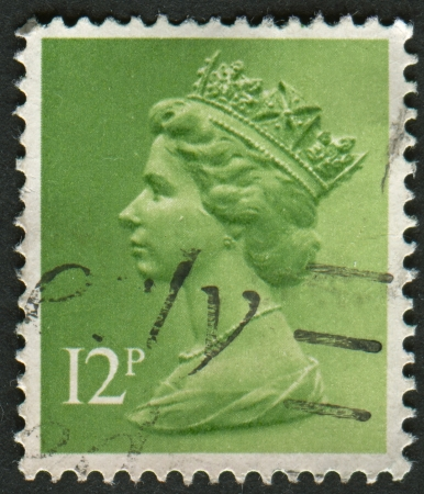 realms: UK-CIRCA 1985: A stamp printed in UK shows image of Elizabeth II is the constitutional monarch of 16 sovereign states known as the Commonwealth realms, in Bright Emerald, circa 1985.