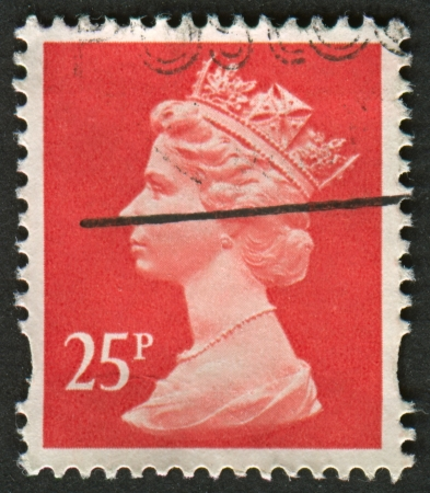 realms: UK-CIRCA 1993: A stamp printed in UK shows image of Elizabeth II is the constitutional monarch of 16 sovereign states known as the Commonwealth realms, in Rose Red, circa 1993.
