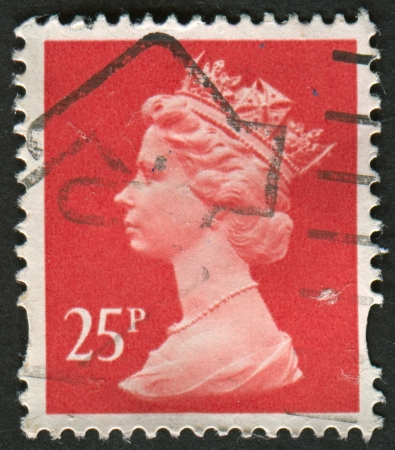 constitutional: UK-CIRCA 1993: A stamp printed in UK shows image of Elizabeth II is the constitutional monarch of 16 sovereign states known as the Commonwealth realms, in Rose Red, circa 1993.
