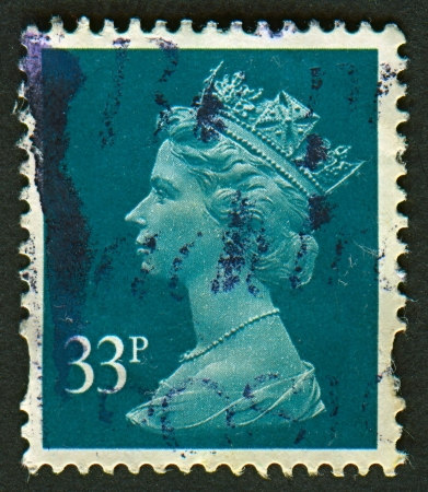 constitutional: UK-CIRCA 2000: A stamp printed in UK shows image of Elizabeth II is the constitutional monarch of 16 sovereign states known as the Commonwealth realms, in Grey Green, circa 2000.