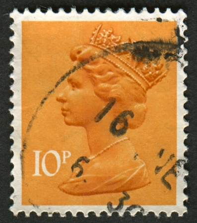 realms: UK-CIRCA 1993:A stamp printed in UK shows image of Elizabeth II is the constitutional monarch of 16 sovereign states known as the Commonwealth realms, in dull orange, circa 1993.