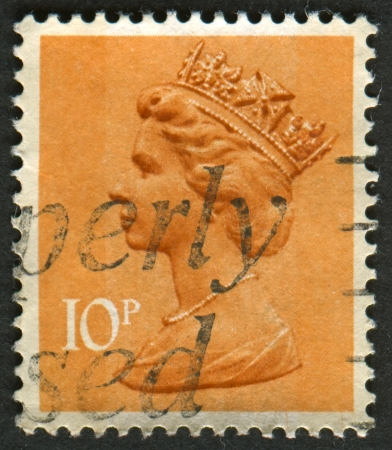 constitutional: UK-CIRCA 1993:A stamp printed in UK shows image of Elizabeth II is the constitutional monarch of 16 sovereign states known as the Commonwealth realms, in dull orange, circa 1993.