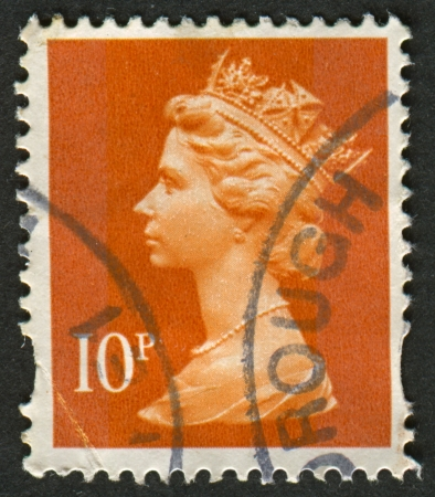 constitutional: UK-CIRCA 1993: A stamp printed in UK shows image of Elizabeth II is the constitutional monarch of 16 sovereign states known as the Commonwealth realms, in dull orange, circa 1993.