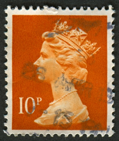 definitive: UK-CIRCA 1993: A stamp printed in UK shows image of Elizabeth II is the constitutional monarch of 16 sovereign states known as the Commonwealth realms, in dull orange, circa 1993.