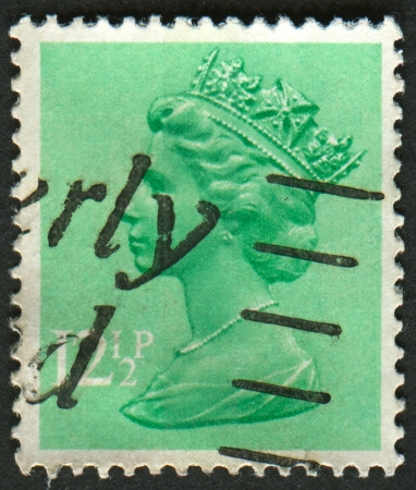 realms: UK-CIRCA 1982:A stamp printed in UK shows image of Elizabeth II is the constitutional monarch of 16 sovereign states known as the Commonwealth realms, in Light Emerald, circa 1982.