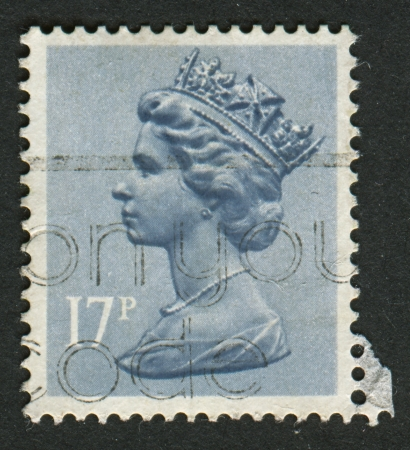 constitutional: UK-CIRCA 1983:A stamp printed in UK shows image of Elizabeth II is the constitutional monarch of 16 sovereign states known as the Commonwealth realms, in Grey Blue, circa 1983.