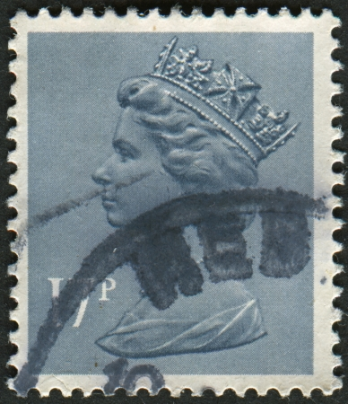 realms: UK-CIRCA 1983:A stamp printed in UK shows image of Elizabeth II is the constitutional monarch of 16 sovereign states known as the Commonwealth realms, in Grey Blue, circa 1983.