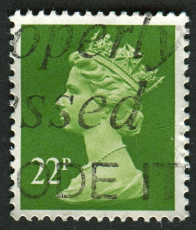 constitutional: UK-CIRCA 1984: A stamp printed in UK shows image of Elizabeth II is the constitutional monarch of 16 sovereign states known as the Commonwealth realms, in Yellow Green, circa 1984.