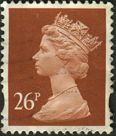 realms: UK-CIRCA 1990: A stamp printed in UK shows image of Elizabeth II is the constitutional monarch of 16 sovereign states known as the Commonwealth realms, in Drab, circa 1990.