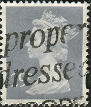 realms: UK-CIRCA 1993: A stamp printed in UK shows image of Elizabeth II is the constitutional monarch of 16 sovereign states known as the Commonwealth realms, in Grey, circa 1993.