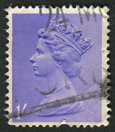 realms: UK-CIRCA 1967: A stamp printed in UK shows image of Elizabeth II is the constitutional monarch of 16 sovereign states known as the Commonwealth realms, in purple, circa 1967.