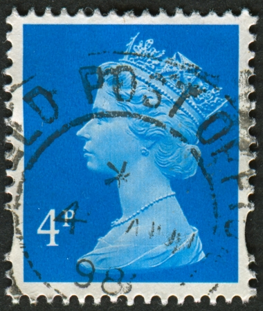 realms: UK-CIRCA 1993: A stamp printed in UK shows image of Elizabeth II is the constitutional monarch of 16 sovereign states known as the Commonwealth realms, in new blue, circa 1993.