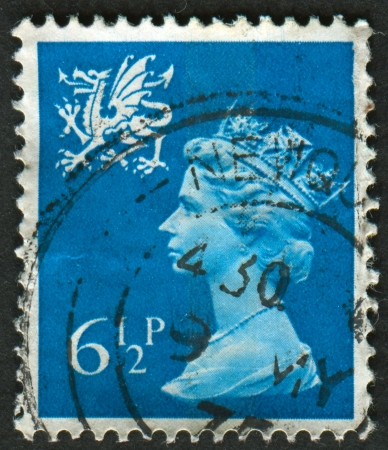 greenish blue: UK-CIRCA 1976: A stamp printed in UK shows image of Elizabeth II is the constitutional monarch of 16 sovereign states known as the Commonwealth realms, in Greenish Blue, circa 1976. Editorial
