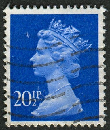 UK-CIRCA 1983: A stamp printed in UK shows image of Elizabeth II is the constitutional monarch of 16 sovereign states known as the Commonwealth realms, in Ultramarine, circa 1983. Editorial