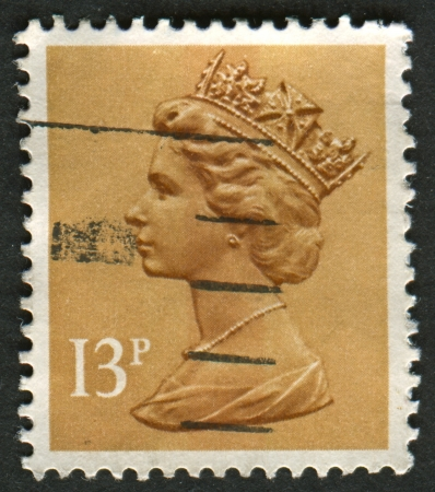 realms: UK-CIRCA 1984: A stamp printed in UK shows image of Elizabeth II is the constitutional monarch of 16 sovereign states known as the Commonwealth realms, in Pale Chestnut, circa 1984.