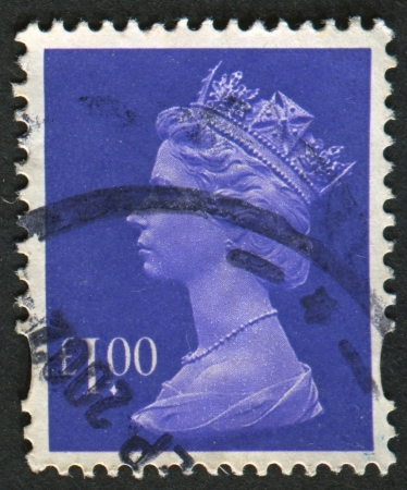 constitutional: UK-CIRCA 1995: A stamp printed in UK shows image of Elizabeth II is the constitutional monarch of 16 sovereign states known as the Commonwealth realms, in Bluish Violet, circa 1995.