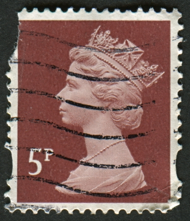 constitutional: UK-CIRCA 1993: A stamp printed in UK shows image of Elizabeth II is the constitutional monarch of 16 sovereign states known as the Commonwealth realms, in dull red-brown, circa 1993.
