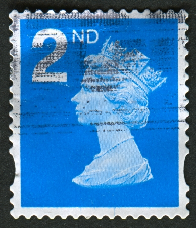 realms: UK-CIRCA 2006: A stamp printed in UK shows image of Elizabeth II is the constitutional monarch of 16 sovereign states known as the Commonwealth realms, in Blue, circa 2006.
