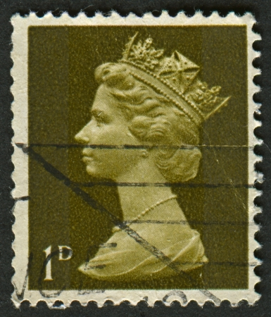 realms: UK-CIRCA 1968: A stamp printed in UK shows image of Elizabeth II is the constitutional monarch of 16 sovereign states known as the Commonwealth realms, in Olive, circa 1968.