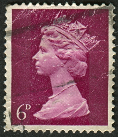 realms: UK-CIRCA 1968: A stamp printed in UK shows image of Elizabeth II is the constitutional monarch of 16 sovereign states known as the Commonwealth realms, in Purple, circa 1968.