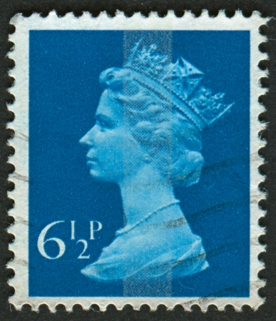 greenish blue: UK-CIRCA 1974: A stamp printed in UK shows image of Elizabeth II is the constitutional monarch of 16 sovereign states known as the Commonwealth realms, in Greenish Blue, circa 1974.