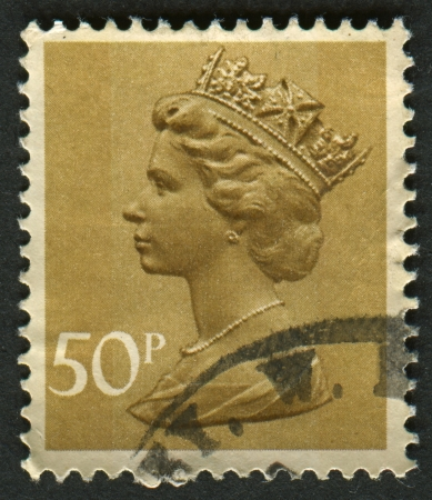 realms: UK-CIRCA 1977: A stamp printed in UK shows image of Elizabeth II is the constitutional monarch of 16 sovereign states known as the Commonwealth realms, in Ochre Brown, circa 1977. Editorial