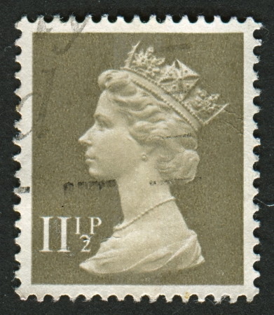 drab: UK-CIRCA 1981: A stamp printed in UK shows image of Elizabeth II is the constitutional monarch of 16 sovereign states known as the Commonwealth realms, in Drab, circa 1981.