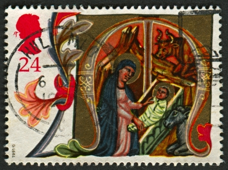 mediaval: UK - CIRCA 1991: A stamp printed in UK shows image of the Mary and Baby Jesus in Stable, circa 1991.