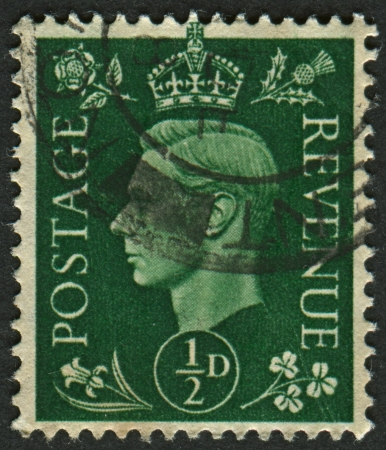 dominions: UK - CIRCA 1950: A stamp printed in UK shows image of the George VI (Albert Frederick Arthur George) was King of the United Kingdom and the Dominions of the British Commonwealth from 11 December 1936 until his death, circa 1950.  Editorial