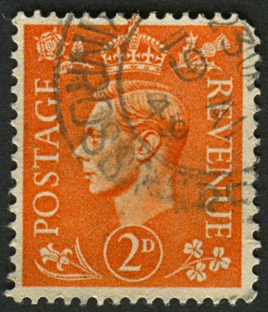 mediaval: UK - CIRCA 1950: A stamp printed in UK shows image of the George VI (Albert Frederick Arthur George) was King of the United Kingdom and the Dominions of the British Commonwealth from 11 December 1936 until his death, circa 1950.  Editorial