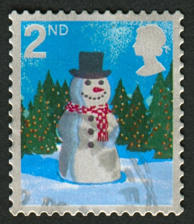 mediaval: UK - CIRCA 2006: A stamp printed in UK shows image of the Snowman, circa 2006.