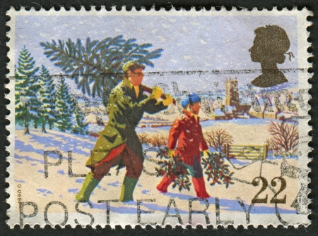 UK - CIRCA 1990: A stamp printed in UK shows image of the Fetching the Christmas Tree, circa 1990.