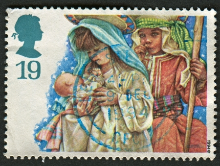 UK - CIRCA 1994: A stamp printed in UK shows image of the Virgin Mary and Joseph, Christmas. Childrens Nativity Plays, circa 1994.