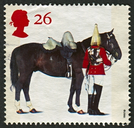 trooper: UK - CIRCA 1997: A stamp printed in UK shows image of the Lifeguards Horse and Trooper,All The Queens Horses. 50th Anniversary of the British Horse Society, circa 1997.