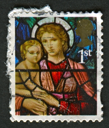 UK - CIRCA 2009: A stamp printed in UK shows image of the Madonna and Child by Henry Holiday, Ormesby St Michael, Ormesby, Great Yarmouth, Norfolk, circa 2009.