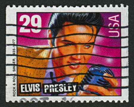 elvis: USA - CIRCA 1993: A stamp printed in USA shows image of the Elvis Aaron Presley a (January 8, 1935 - August 16, 1977) was an American singer, musician and actor, circa 1993.