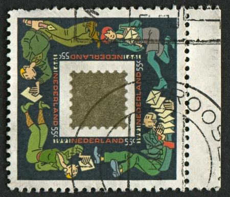 nederland: NEDERLAND - CIRCA 1991: A stamp printed in Nedrland shows image of the Mail Nederland, circa 1991.  Editorial
