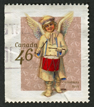 mediaval: CANADA - CIRCA 1999: A stamp printed in Canada shows image of the Christmas Noel, circa 1999.