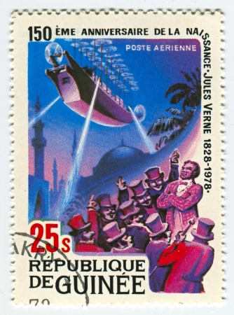 novelist: GUINEA - CIRCA 1978: A stamp printed in Guinea shows image of the Jules Verne novels, circa 1978.