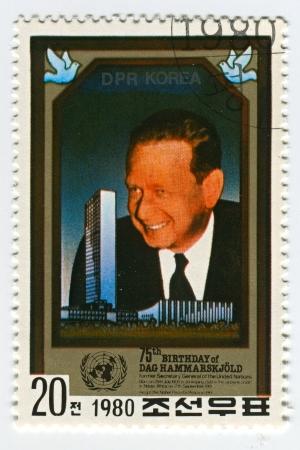 carl: NORTH KOREA - CIRCA 1980: A stamp printed in North Korea shows image of the Dag Hjalmar Agne Carl Hammarskjold was a Swedish diplomat, economist, and author, circa 1980.