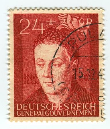 DEUTSCHES REICH  - CIRCA 1942: A stamp printed in Deutsches Reich shows image of the Hans Durer (born February 21, 1490 in Nuremberg - ca. 1538), was a German Renaissance painter, illustrator, and engraver, circa 1942. Stock Photo - 21900591