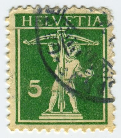 eros: SVIZZERA - CIRCA 1930: Un timbro stampato in Svizzera mostra l'immagine di Eros, nella mitologia greca, era il dio greco dell'amore, circa 1930.