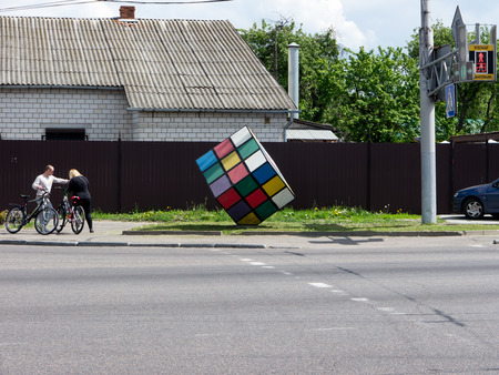 rubik: GOMEL, BELARUS - MAY 14, 2014: Rubiks Cube as a monument on a city street. Rubiks Cube is a 3-D combination puzzle invented in 1974 by Hungarian sculptor and professor of architecture Erno Rubik.