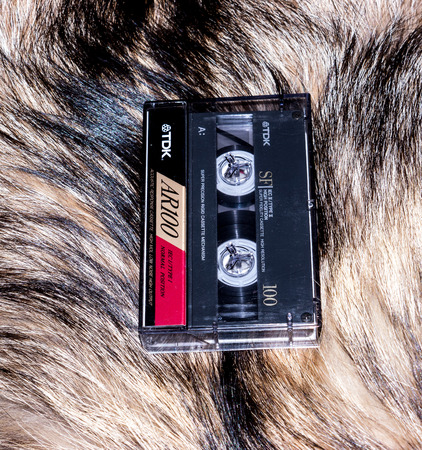 tdk: GOMEL, BELARUS - JUNE 11, 2014: TDK cassette tape  on fur background. TDK Corporation, is a Japanese multinational electronics company that manufactures electronic materials, electronic components, and recording and data-storage media.