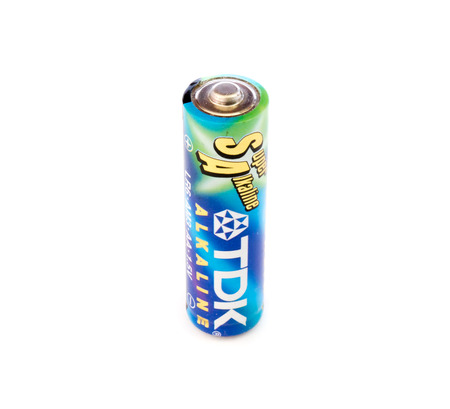 tdk: GOMEL, BELARUS - JUNE 22, 2014: TDK AA alkaline battery on a white background. TDK Corporation, is a Japanese multinational electronics company that manufactures electronic materials, electronic components, and recording and data-storage media.