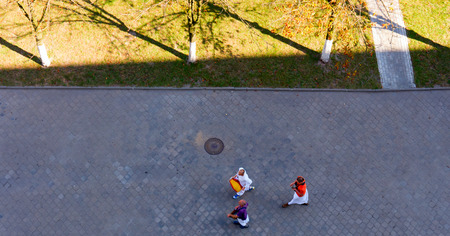 hectic life: GOMEL, BELARUS - SEPTEMBER 12: Buddhists, walking down the street on September15, 2014 in Gomel, Belarus. Editorial