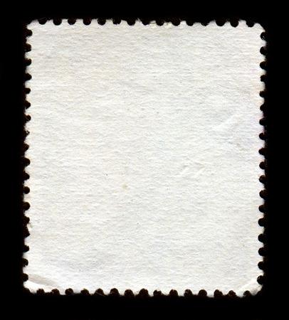 El reverso de un sello postal.  Foto de archivo